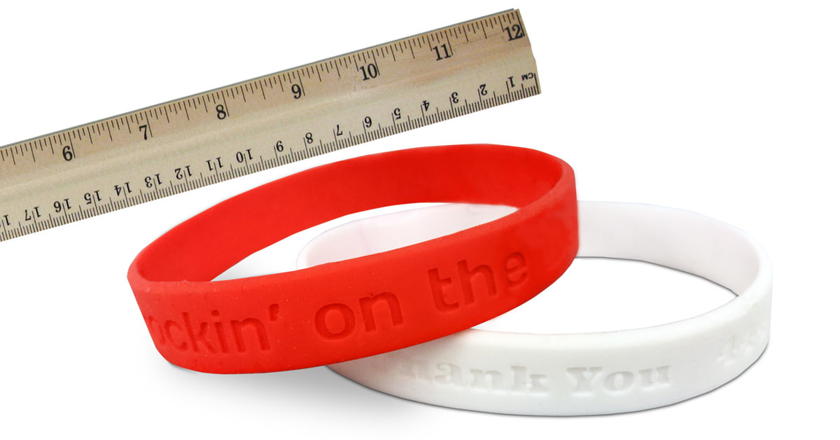 rubber bracelet size image showing ruler and two wristbands