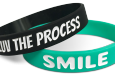 positive half inch wristbands saying smile and love the process