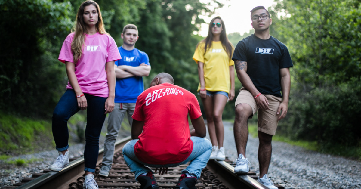 D17 clothing models standing on train tracks