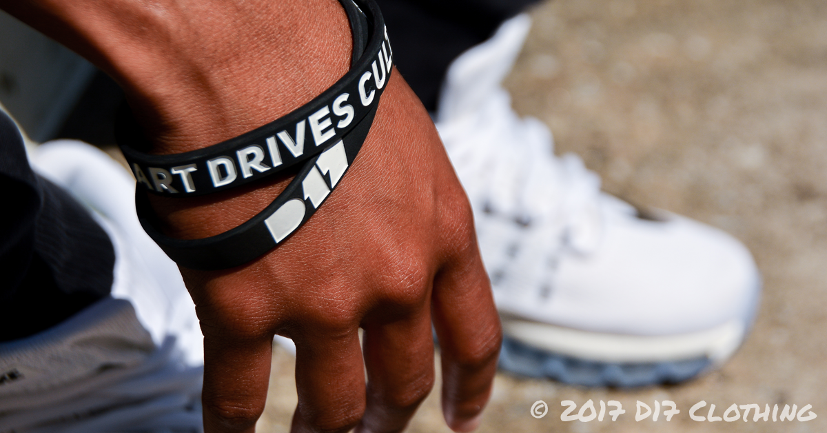 d17 clothing wristband in black with white text being worn on wrist