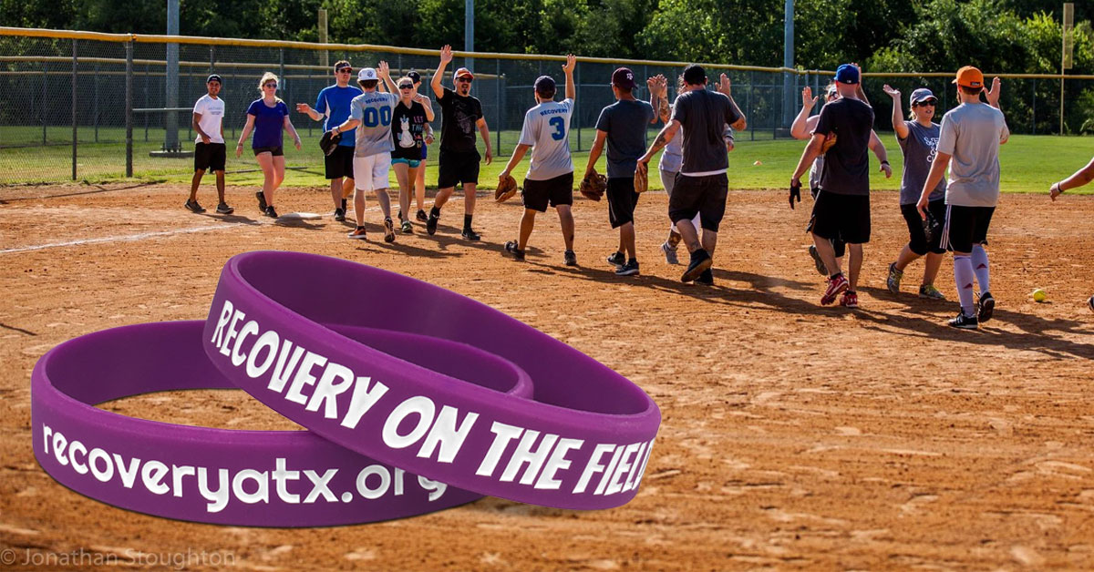 recovery atx wristbands on softball field
