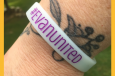 #evanunited wristbands worn on a wrist