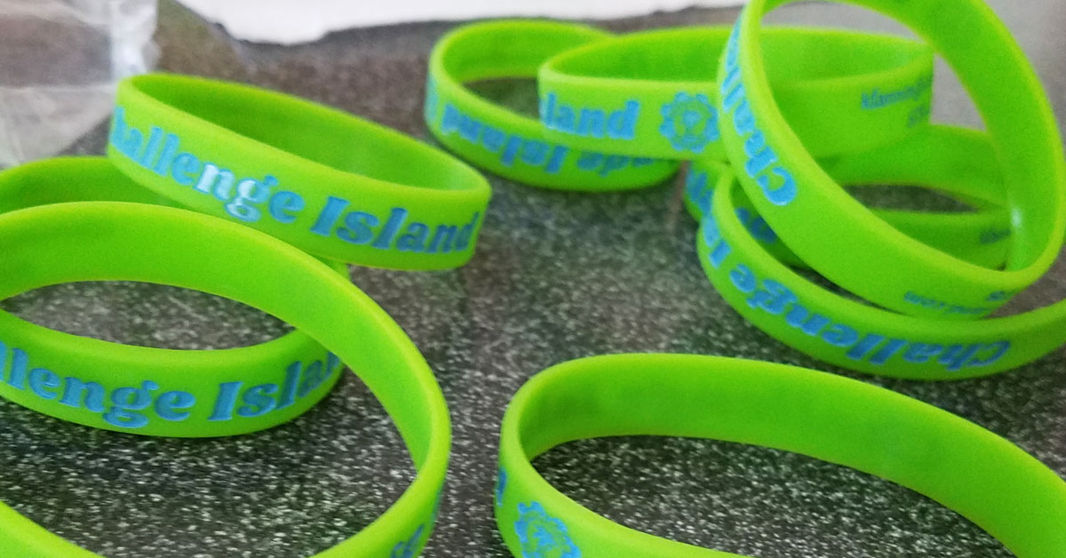 wristbands for challenge island on table