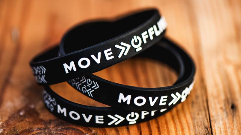 the offline movement wristbands on wood grain