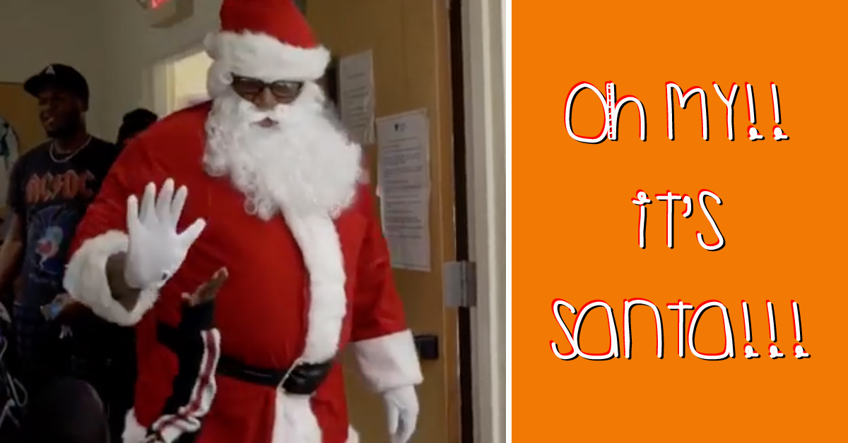 oh my its santa text with image of santa high fiving child