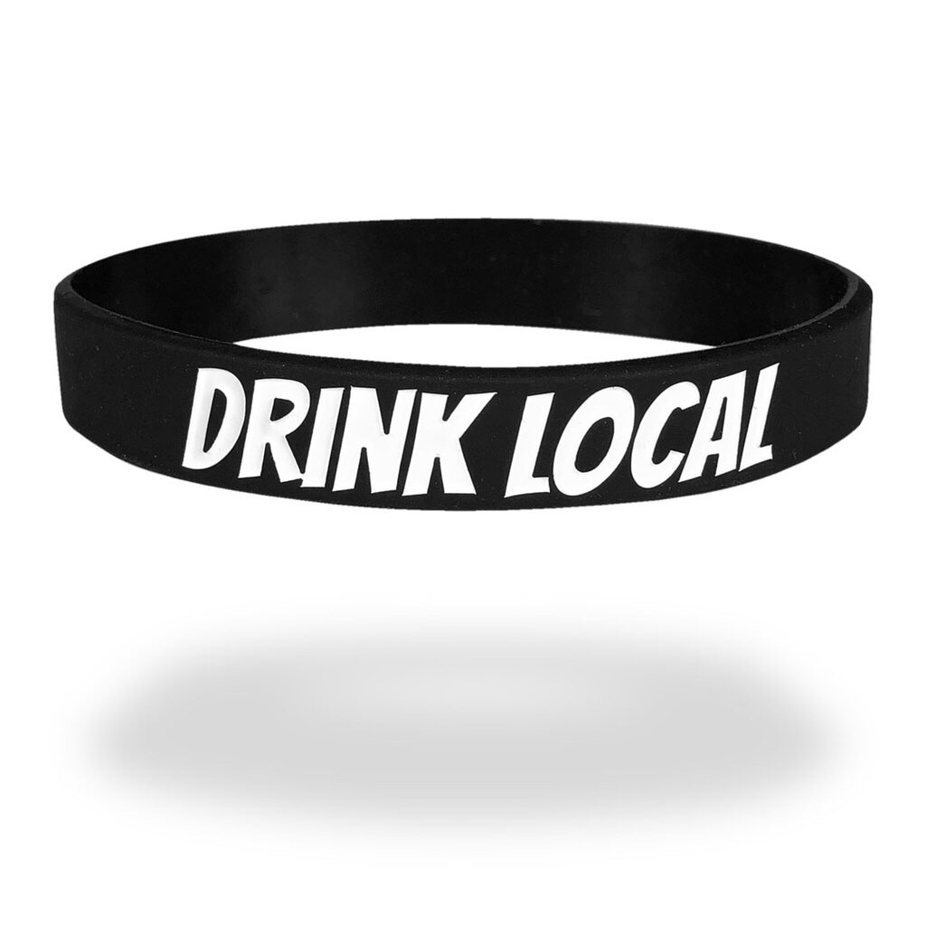black event wristband with white text saying Drink Local