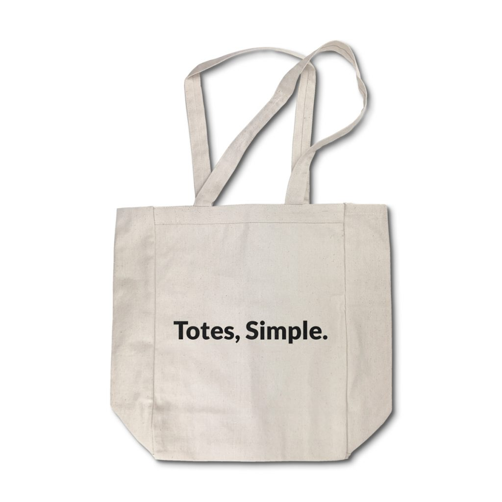 A Natural Heavy Cotton Tote with the words Totes, Simple screen printed on the surface.