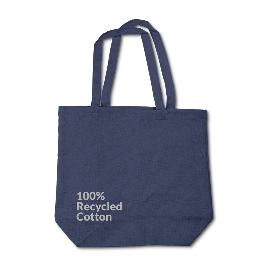 A Navy Recycled Cotton Tote with the words 100% Recycled Cotton screen printed on the surface.